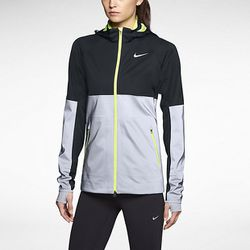 """Reflective running gear can keep you both toasty and safe during the dark days of winter. Caroline recommends the Nike Shield Flash Jacket because it's perfect for """"staying warm, stylish, and seen when out running."""" <i>Nike Shield Flash Running Jacket, $3"""