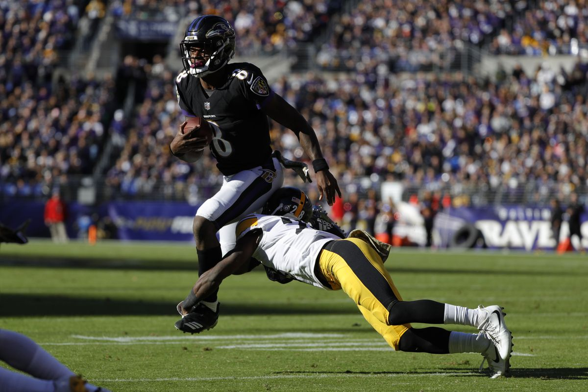 Quarterback Lamar Jackson of the Baltimore Ravens is tackled as he carries the ball by cornerback Mike Hilton of the Pittsburgh Steelers in the second quarter at M&T Bank Stadium on November 4, 2018 in Baltimore, Maryland.
