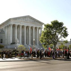 Crowds gather outside the United States Supreme Court building in Washington, D.C., as the justices hear arguments concerning gay marriage, on Tuesday, April 28, 2015.