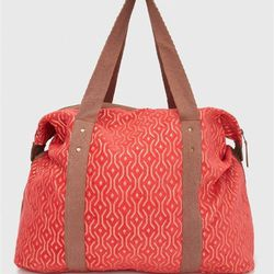 """This bright Roxy duffle (<A href=""""http://www.roxy.com/breakaway-duffle-bag/rxyus465141#selectedColor=mmn0&type=0""""target=""""_blank"""">$74</a>) will immediately tell your flight seat mates that you're going somewhere fun, sunny and jealous-inducing."""