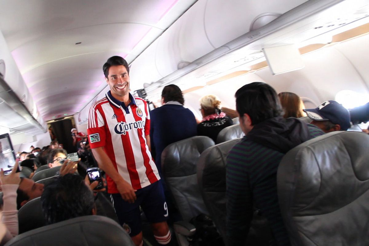 JPA trying to avoid the beverage cart on his way down the aisle. (Source: Juan Paz, courtesy of MLSsoccer.com)