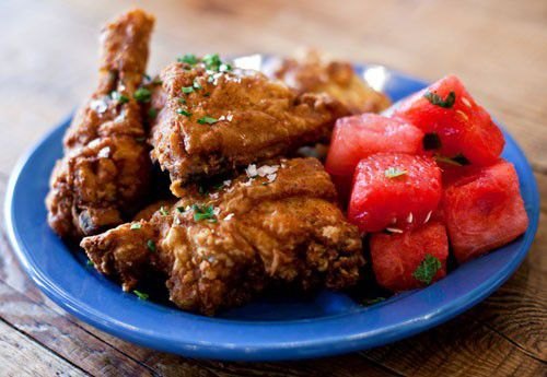 Chicken and waffles prepared with chilled spiced watermelon at Yardbird
