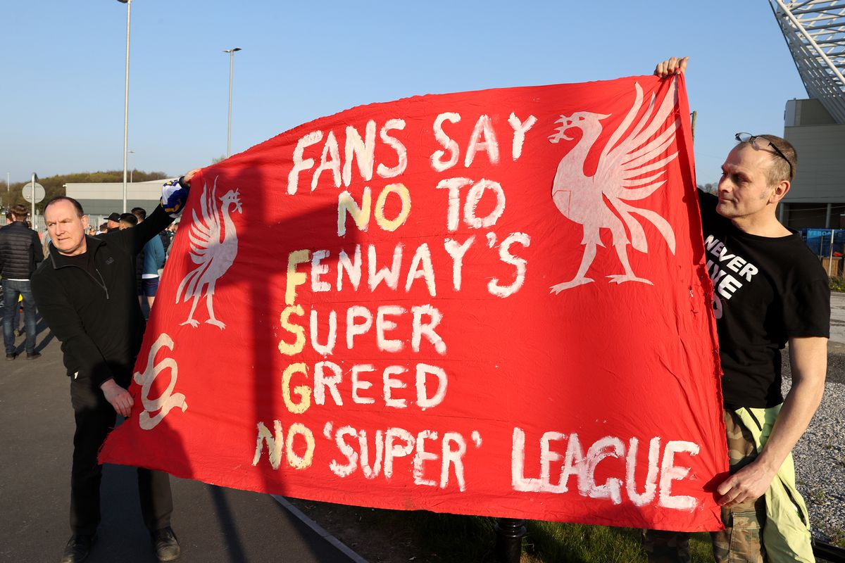 Fans hold up a protest banner against Liverpool FC and the European Super League outside the stadium prior to the Premier League match between Leeds United and Liverpool at Elland Road