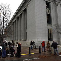 News crews wait for the jury's decision on the Brian David Mitchell trial at the Frank E. Moss United States Courthouse in Salt Lake City Friday.