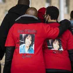 Family and supporters of Tafara Williams wear matching shirts and hold a prayer circle after a press conference outside Waukegan's city hall complex, Tuesday morning, Oct. 27, 2020. Williams, 20, was wounded and her boyfriend, 19-year-old Marcellis Stinnette, was killed when they were both shot by a Waukegan police officer on Oct. 20.