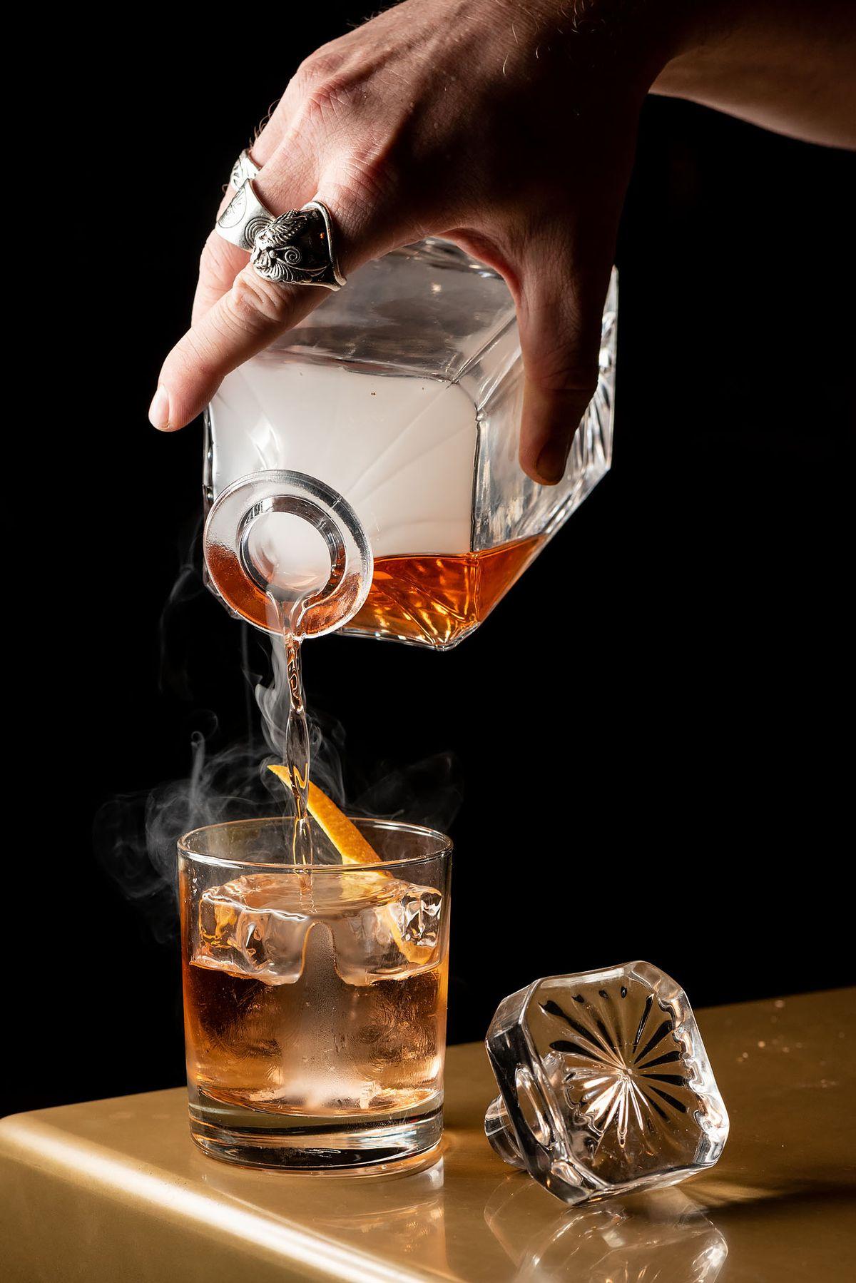 mixtape pouring smoke cocktail glass table