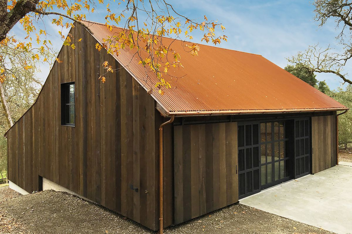 Timber clad home with steel roof