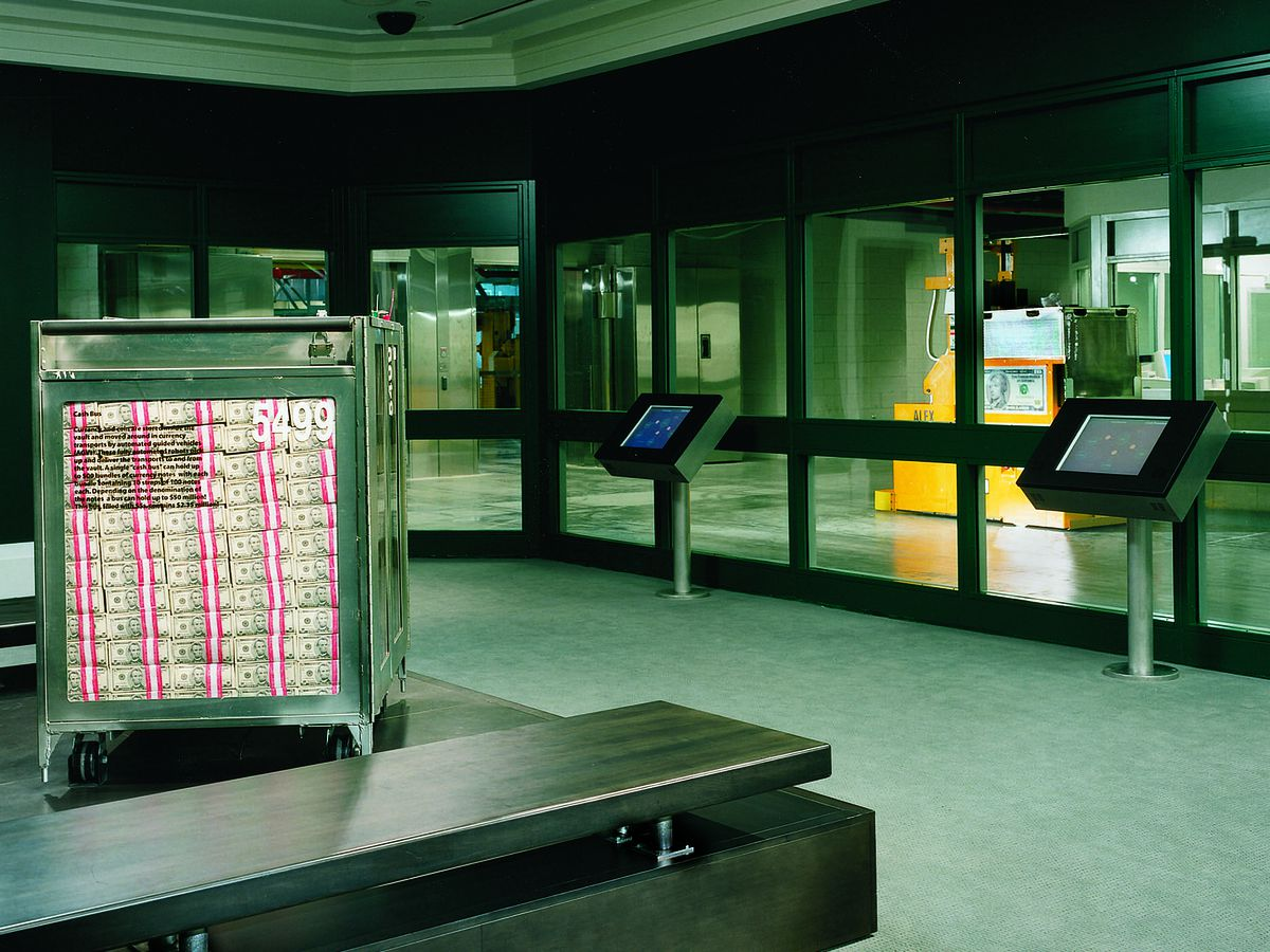 A vault with a large container of paper money.