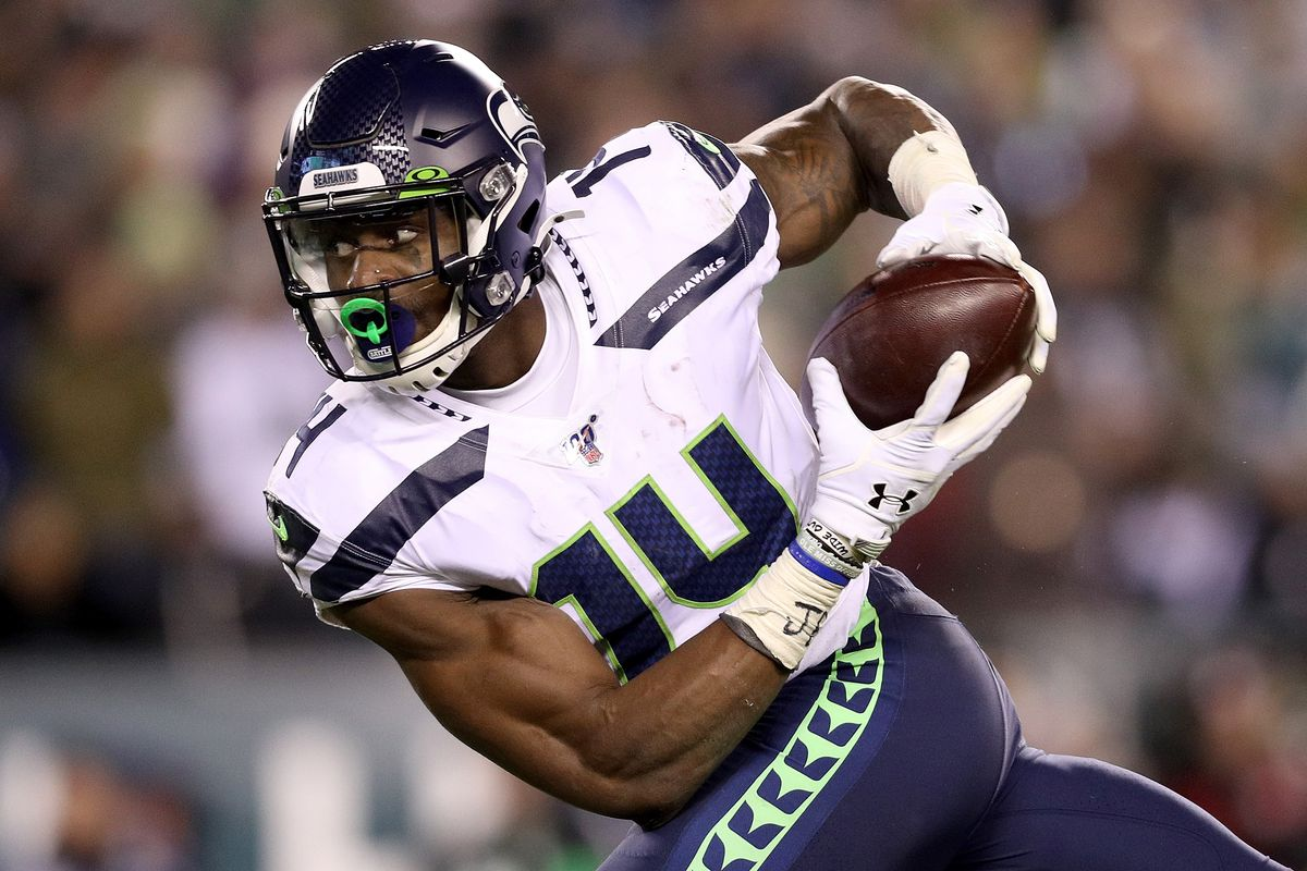 D.K. Metcalf #14 of the Seattle Seahawks makes a reception for a touchdown against the Philadelphia Eagles in the third quarter during their NFC Wild Card Playoff game at Lincoln Financial Field on January 05, 2020 in Philadelphia, Pennsylvania.