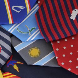 Noel Lopez's company, The Town and Co., features neckties representing 23 countries and two states. Each necktie is designed to serve as a conversation piece that allows the wearer to share his stories with others.