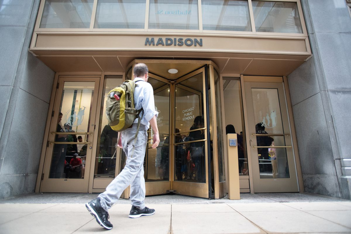 A man walks up to the entrance to the Chicago Public School headquarters at 42 W Madison Street in Chicago, Illinois.   Colin Boyle/Sun-Times