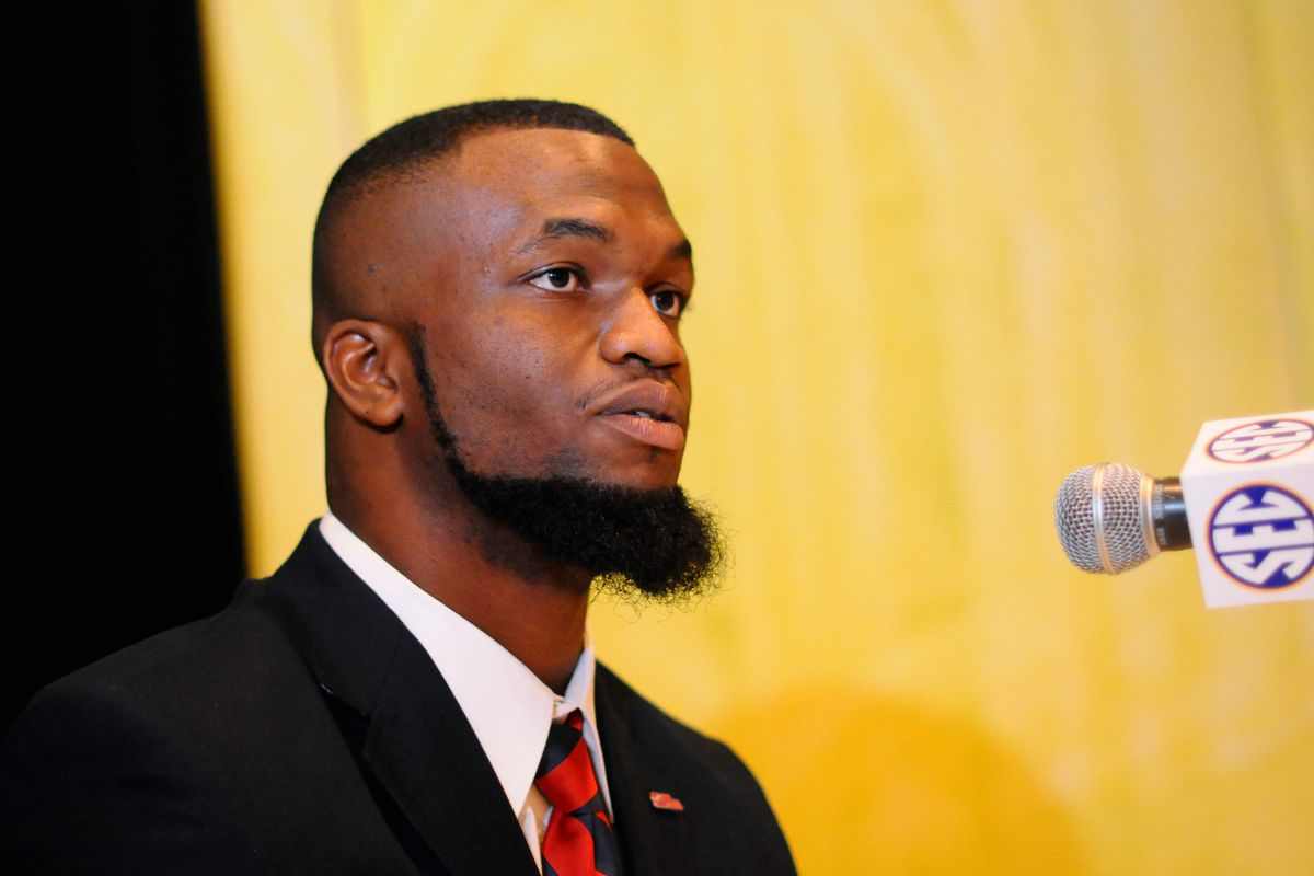 """Amish Deacon and Ole Miss linebacker Mike """"Jeddidiah"""" Marry is seen here speaking into a devil tube at SEC Media Days in Hoover, Alabama."""