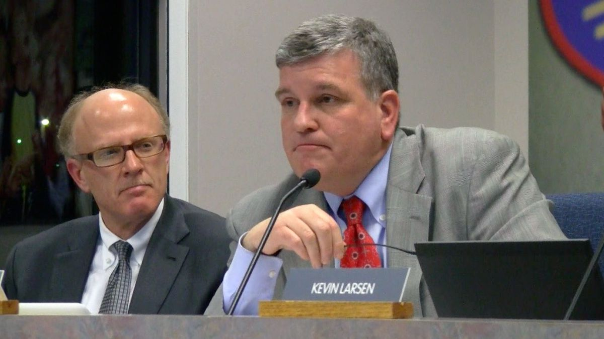 Dougco school board president John Carson, right, responded to several speakers' questions Tuesday and called on staff to add details.