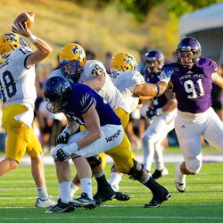 McNeese State quarterback Cody Stroud passes under pressure Weber State defenders during the second quarter of an NCAA college football game Saturday, Sept. 15, 2012, in Ogden, Utah. (AP Photo/Standard-Examiner, Dennis Montgomery)