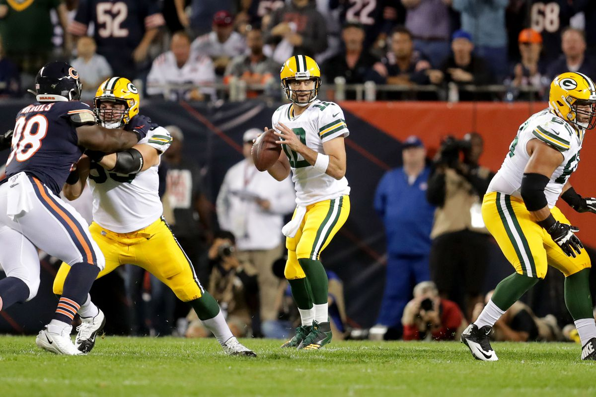 Green Bay Packers quarterback Aaron Rodgers looks to pass the ball during the first half against the Chicago Bears at Soldier Field.