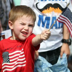 Ruger Core, 3, watches the Fourth of July parade in Kaysville on Saturday, July 4, 2015.