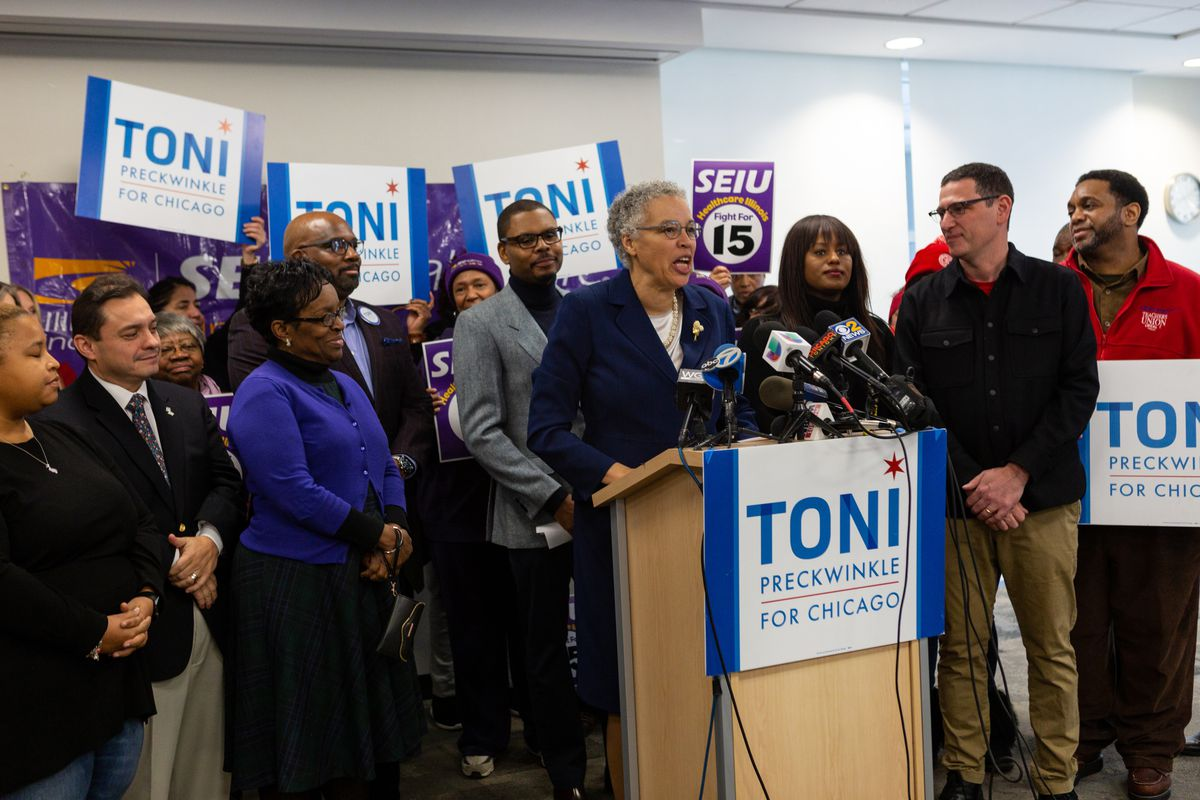 In December, Toni Preckwinkle recieved endorsements from three powerful progressive unions, including the Chicago Teachers Union, whose vice president Stacey Gates and president Jesse Sharkey are standing right of the podium.