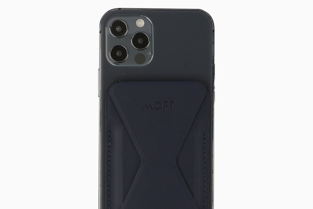 A photo of an iPhone 12 Pro with the MOFT wallet