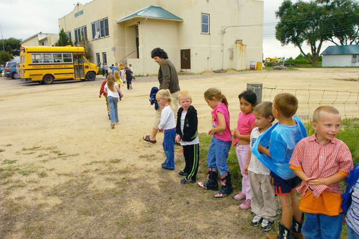 In this 2007 photo, Edison School kindergarteners head back to class in their 1922 school building (Photo by Karl Gehring/The Denver Post)