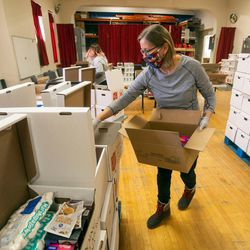 A volunteer helps pack food at the local Salvation Army in Salt Lake City on Tuesday, Dec. 15, 2020.