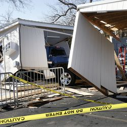 Construction workers assessed damage to a COVID-19 test site at the University of Utah Rice-Eccles Stadium in Salt Lake City on Thursday, November 5, 2020. One man on a pickup that the police believe is