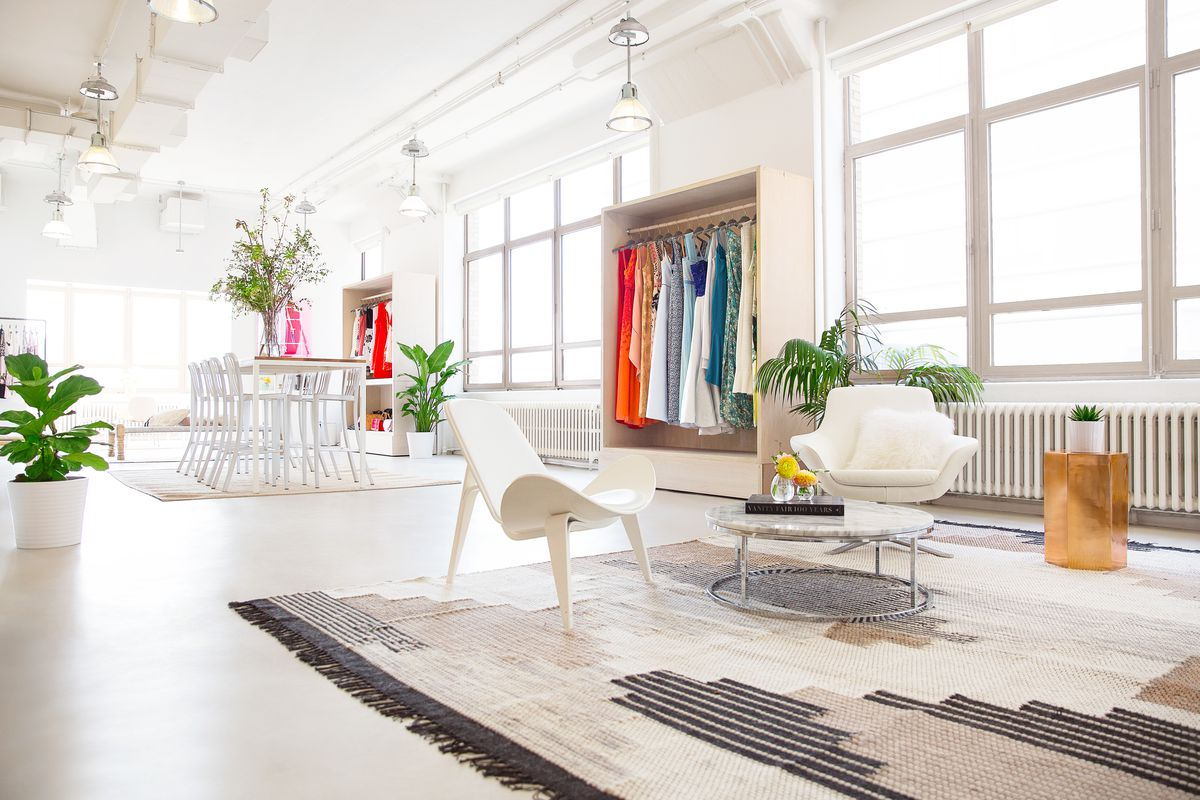 The bright, mostly white Rent the Runway style studio