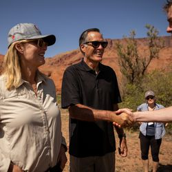 Ann Romney, left, and her husband, Sen. Mitt Romney, R-Utah, say goodbye to Sen. Michael Bennet, D-Colo., after they rafted a section of the Colorado River northeast of Moab on Saturday, Sept. 18, 2021.
