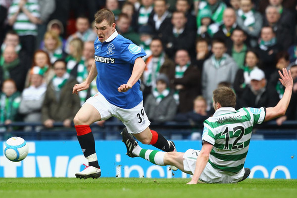 GLASGOW, SCOTLAND - MARCH 20:  Mark Wilson of Celtic tackles Gregg Wylde of Rangers during the Co-operative Insurance Cup Final between Celtic and Rangers at Hampden Park on March 20, 2011 in Glasgow, Scotland. (Photo by Jeff J Mitchell/Getty Images)