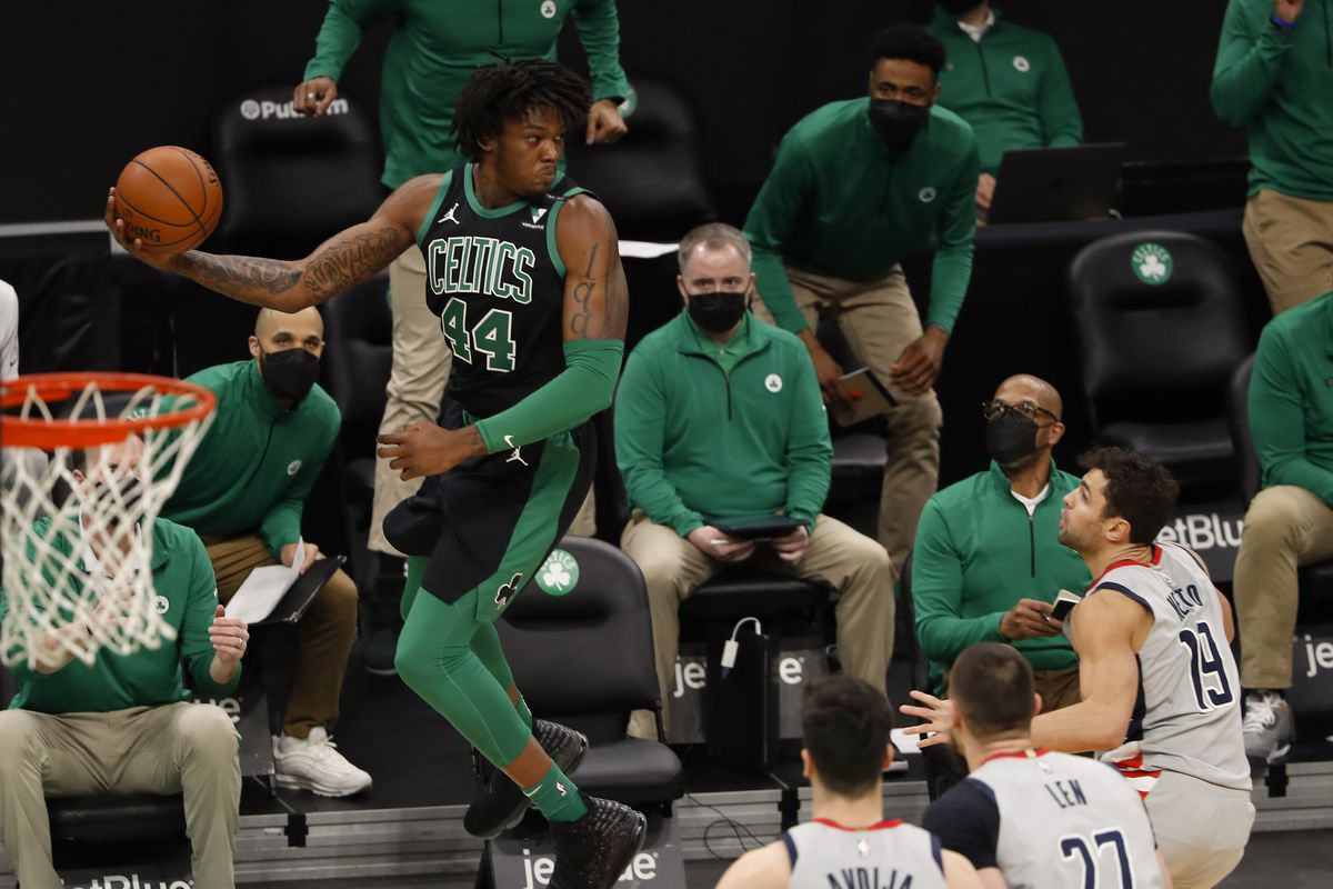 Boston Celtics center Robert Williams III (44) leaps to save the ball from going out of bounds during the first quarter against the Washington Wizards at TD Garden. Mandatory Credit: Winslow Townson