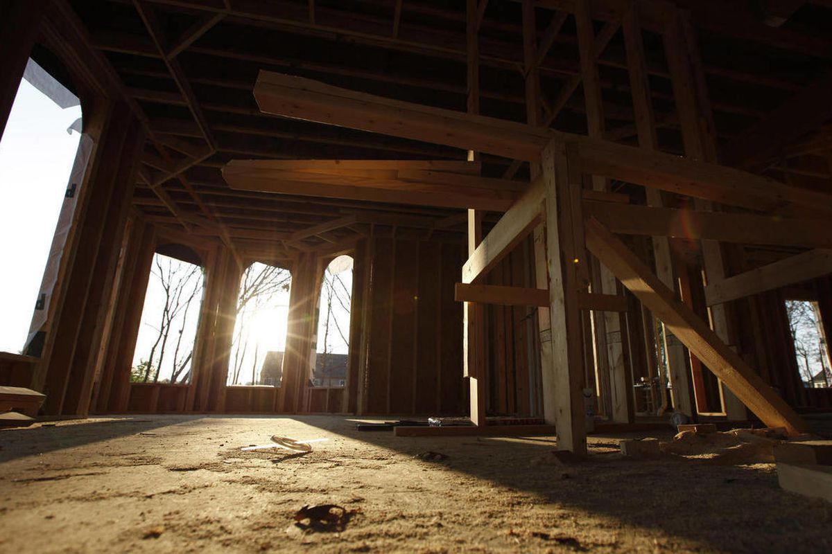In a Friday, March 23, 2012 photo, sun streams through window cutouts in an unfinished home in Richmond, Va. Sales of new homes fell in March 2012 by the largest amount in more than a year, indicating that the U.S. housing market remains under strain desp