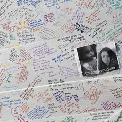 Messages on a wall for the victims and in support for those affected by the massive fire in Grenfell Tower, in London, Thursday, June 15, 2017. A massive fire raced through the 24-story high-rise apartment building in west London early Wednesday.
