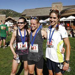 Top women finishers Rachael Cuellar (third), Liz Stephen (second) and Morgan Arritola, left to right, the the finish of the XTERRA Trail Running National Championship Half Marathon race  Sunday, Sept. 25, 2011, in Snowbasin, Utah.