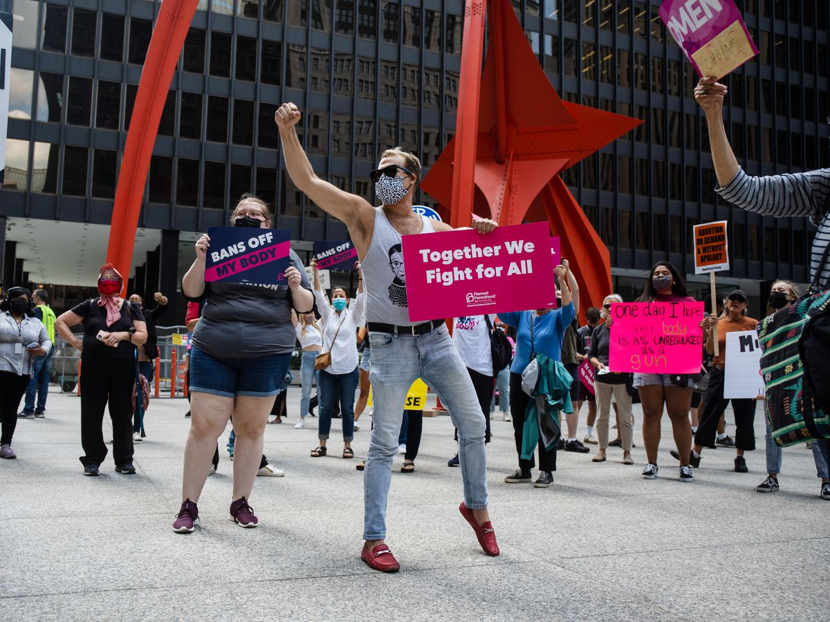 """Opponents of Texas' new law banning most abortions demonstrated at the """"Bans Off My Body"""" rally at Federal Plaza in the Loop, Friday afternoon, Sept. 10, 2021. The rally was organized by several local organizations, including Illinois Handmaids and Planned Parenthood Illinois Action."""