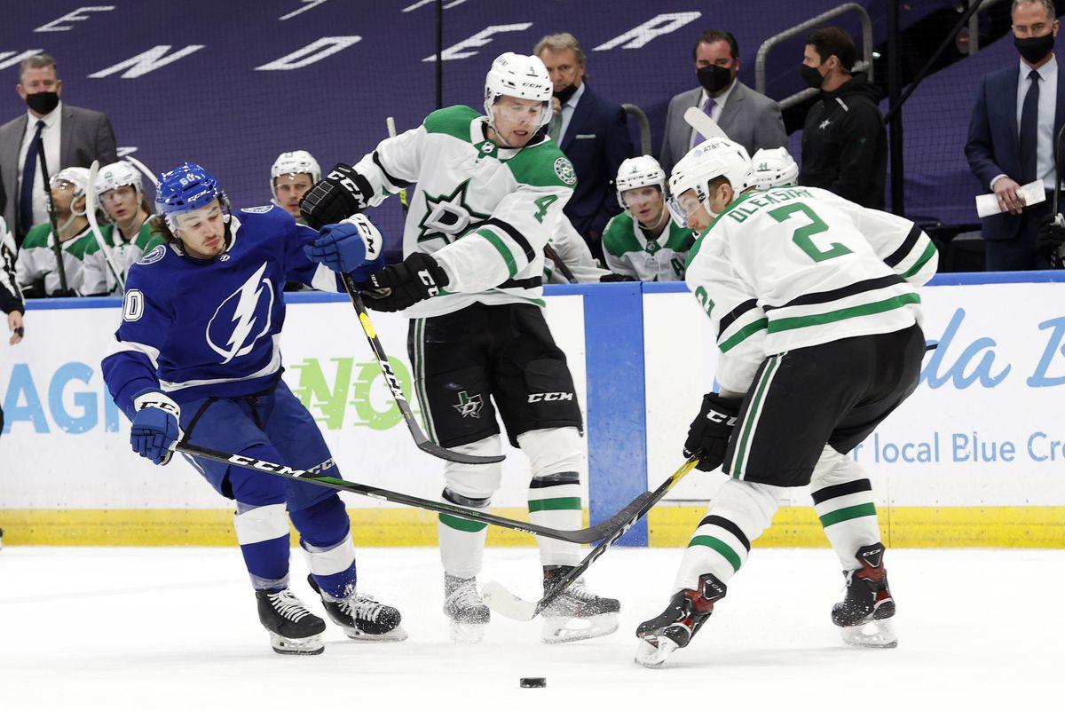 Miro Heiskanen and Jamie Oleksiak protect the puck against the Lightning in Tampa, Florida.