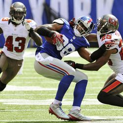 Tampa Bay Buccaneers cornerback Aqib Talib, right, and Ahmad Black, left, pressure New York Giants wide receiver Hakeem Nicks (88) after he made a catch during the first half of an NFL football game, Sunday, Sept. 16, 2012, in East Rutherford, N.J.