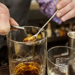 He adds 1/4 part, about a bar spoon, of house-made cinnamon syrup. The sweet syrup, which is meant to balance out the bitters, is made from equal parts cinnamon stick and sugar.