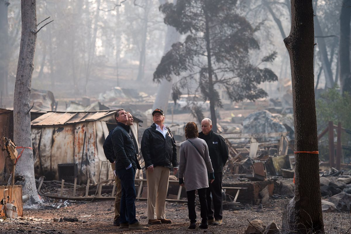 Trump surveys damage from the Camp Fire, California's deadliest fire on record, with then Governor-elect Gavin Newsom (left) on on November 17, 2018. Trump has blamed the state's forest management for the fire even though the federal government owns most