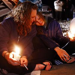 Debbie (no last name given) and her daughter, Ashley Forsland, sit on the ground during a candlelight vigil for Ronnie Lee Gardner. The execution warrant for Ronnie Lee Gardner was carried out at 12:17 a.m. at the Utah State Prison on Friday.
