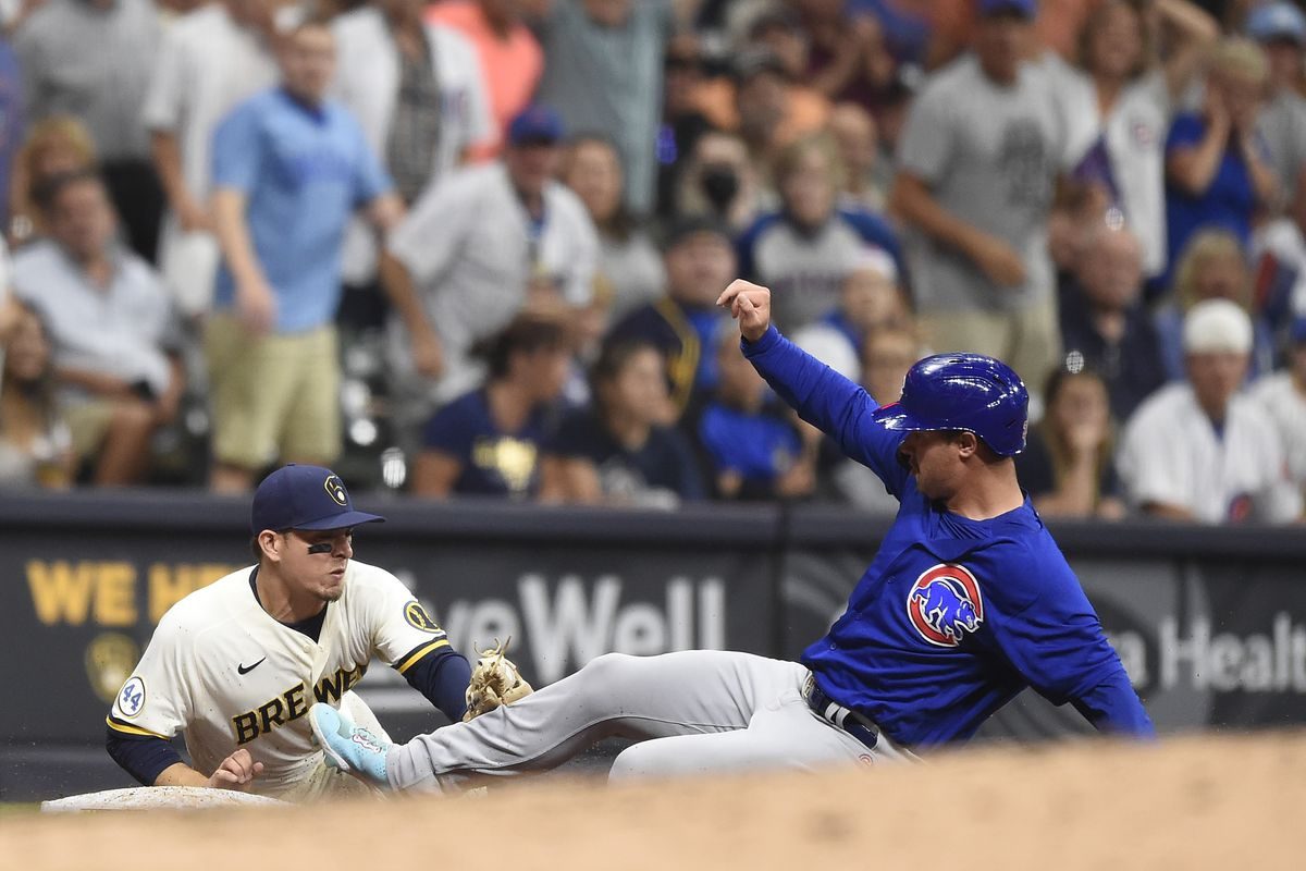 Joc Pederson is tagged out by Brewers third baseman Luis Urias.