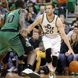 Utah Jazz shooting guard Gordon Hayward (20) drives to the basket as Boston Celtics power forward Brandon Bass (30) defends during a game at EnergySolutions Arena on Monday, Feb. 24, 2014.