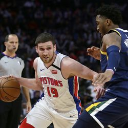 Detroit Pistons guard Sviatoslav Mykhailiuk (19) drives against Utah Jazz guard Donovan Mitchell (45) during the first half of an NBA basketball game Saturday, March 7, 2020, in Detroit.