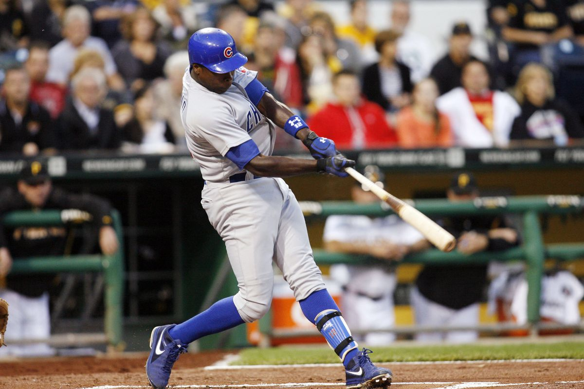 September 8, 2012; Pittsburgh, PA, USA; Chicago Cubs left fielder Alfonso Soriano (12) hits a solo home run against the Pittsburgh Pirates during the second inning at PNC Park. Mandatory Credit: Charles LeClaire-US PRESSWIRE