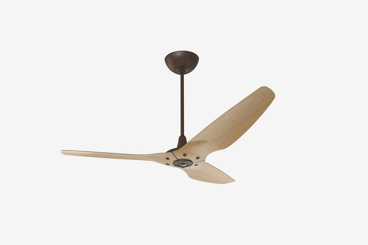 Ceiling fan with three wooden blades.