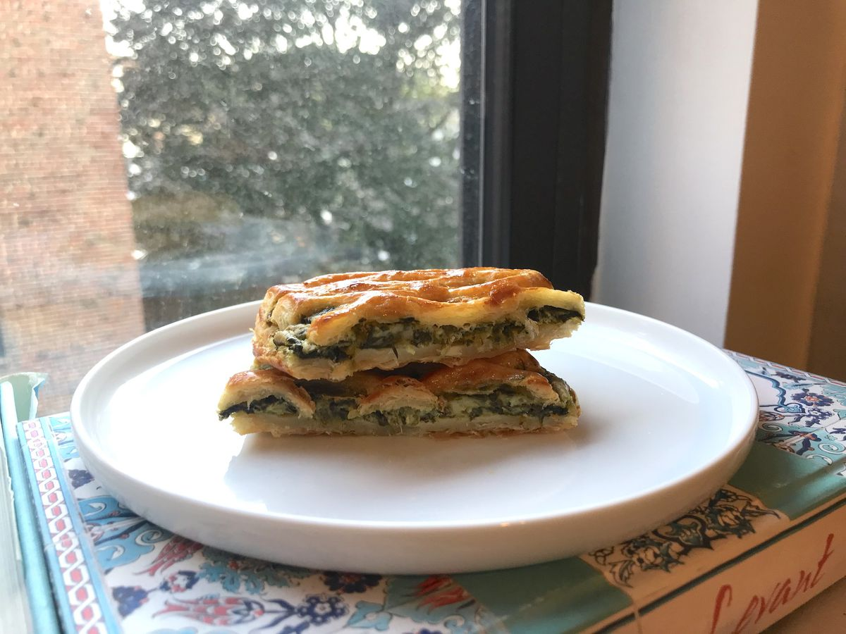 A plate of spinach con queso pastry