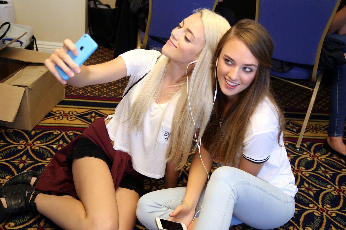 Two young women take a selfie