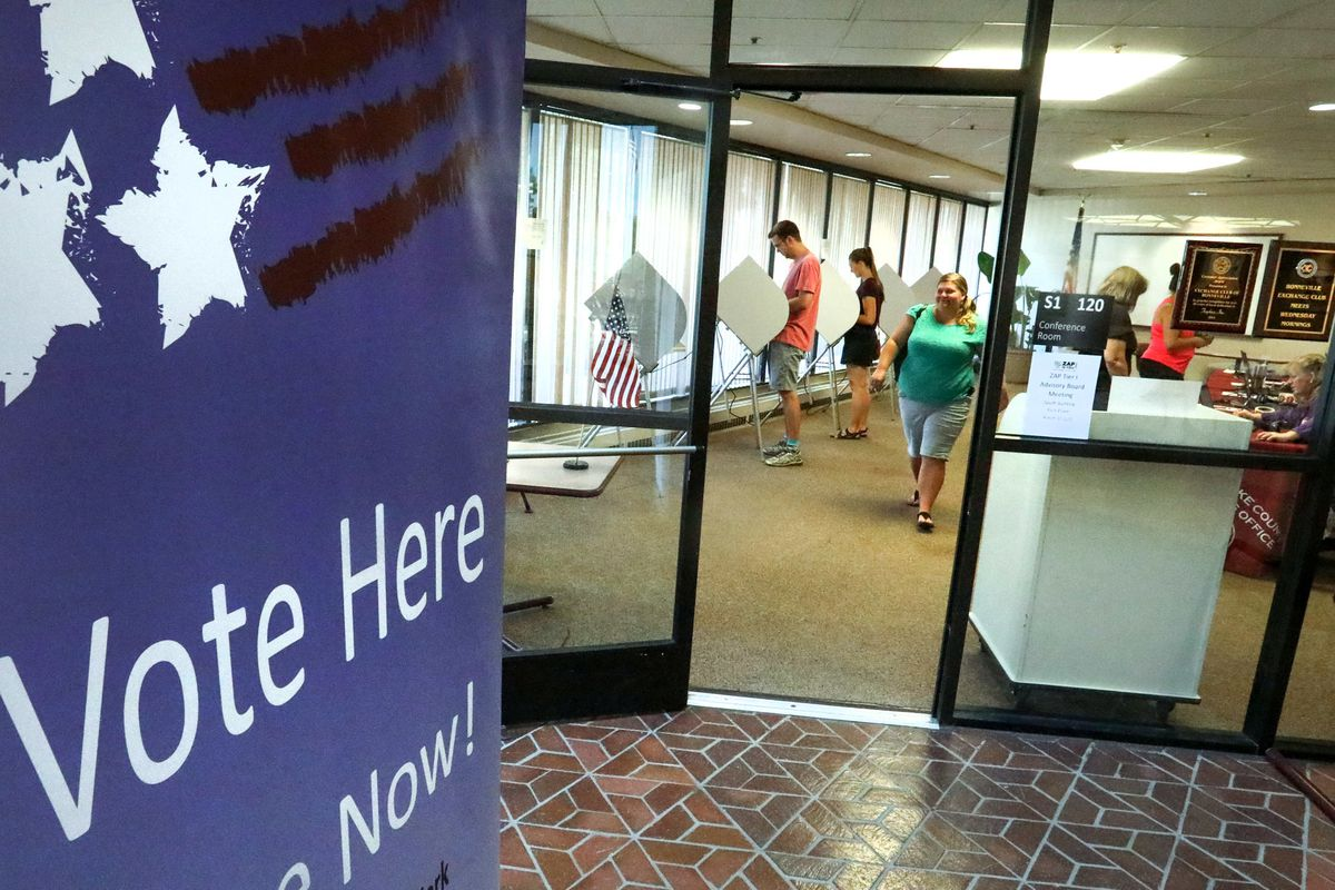 FILE - Citizens cast their ballots at the Salt Lake County Government Center on Election Day Tuesday, June 26, 2018.