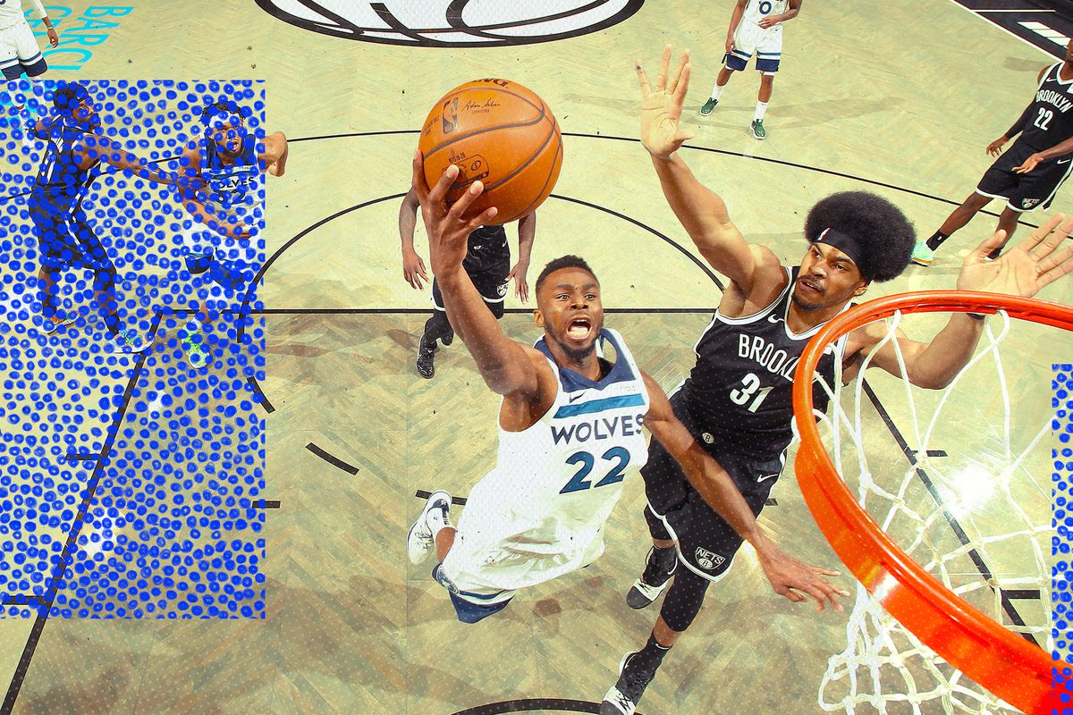 Andrew Wiggins attempts a shot at the basket for the Timberwolves.