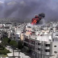 This image made from amateur video and released by Shaam News Network Friday, April 20, 2012, purports to show an explosion amid heavy shelling in the Khaldiyeh area of Homs, Syria.