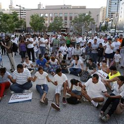 Participants hold hands and pray during a vigil for immigration reform in Salt Lake City, Thursday, June 27, 2013.