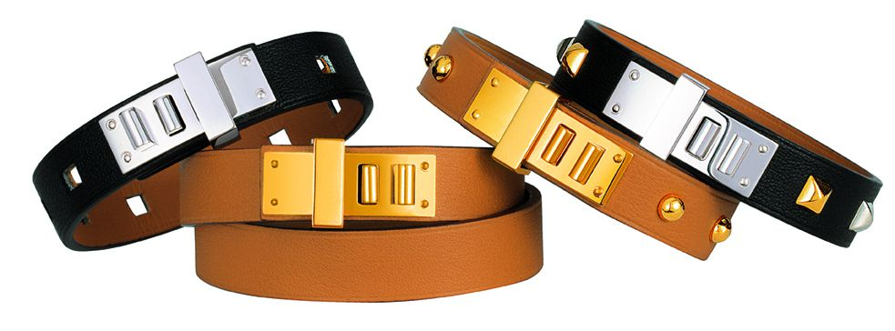 A variety of black and tan leather bracelets with silver and gold buckles.
